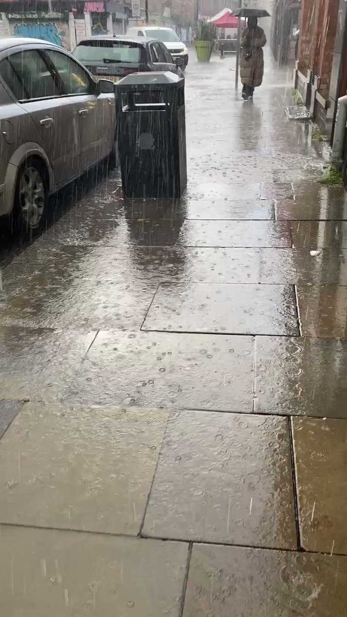 It's raining a tad.