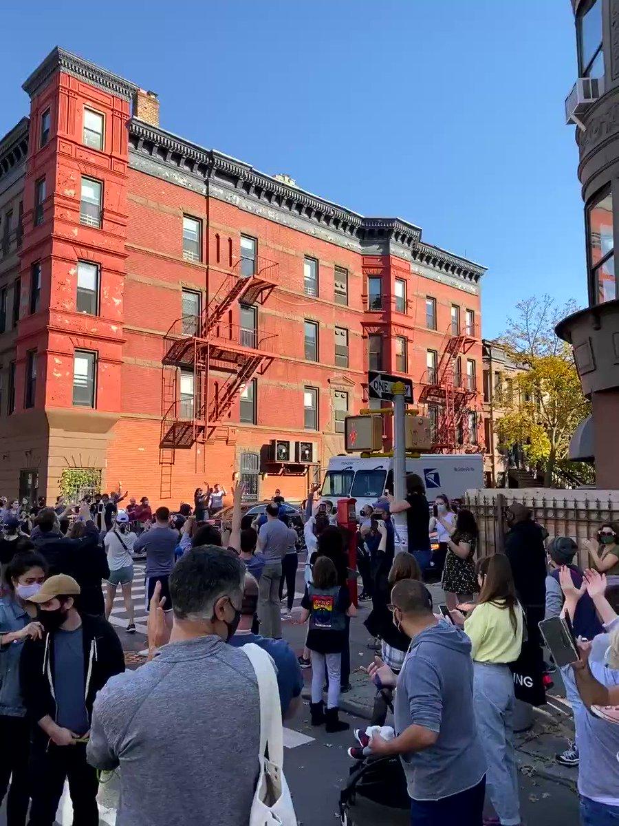 Brooklynites cheering the mail truck! LFG!