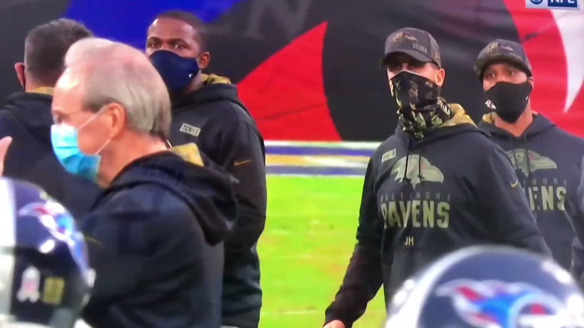 Mike Vrabel came over to shake hands with John Harbaugh and Harbaugh appears to wave him off.