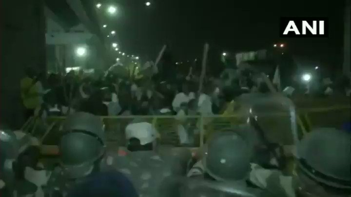 #Delhi: #Farmers continue their protest at Ghazipur-Ghaziabad (Delhi-UP) border against the farm laws amid security deployment.  Visuals of farmers trying to break through the barricades at Ghazipur, Delhi. (ANI)