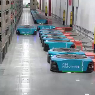 Image for the Tweet beginning: Robots in Warehouse #AI #ArtificialIntelligence