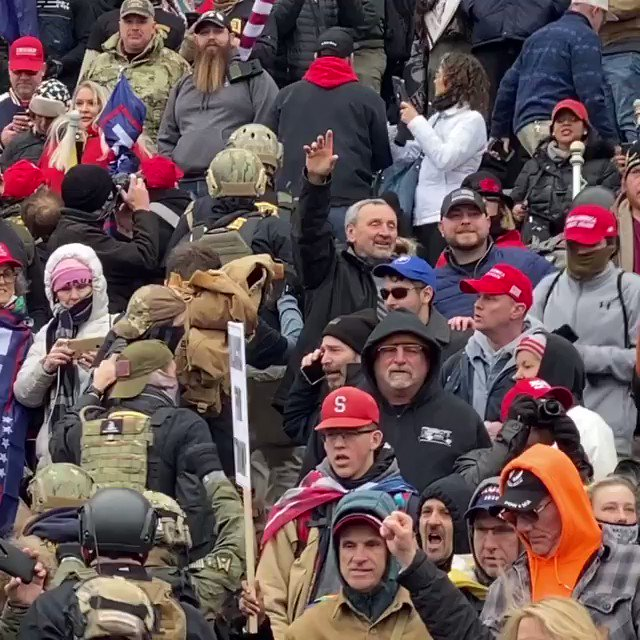 NEW FOOTAGE: a long, disciplined line of men in body armor moves as a unit up the #CapitolBuilding steps.    We need to identify this group.   Grateful to @lehudgins for the find. Source: