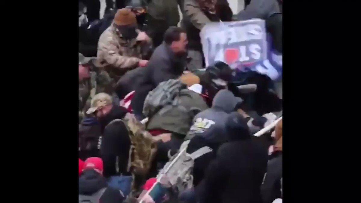Terrorist beats an officer with an American Flag