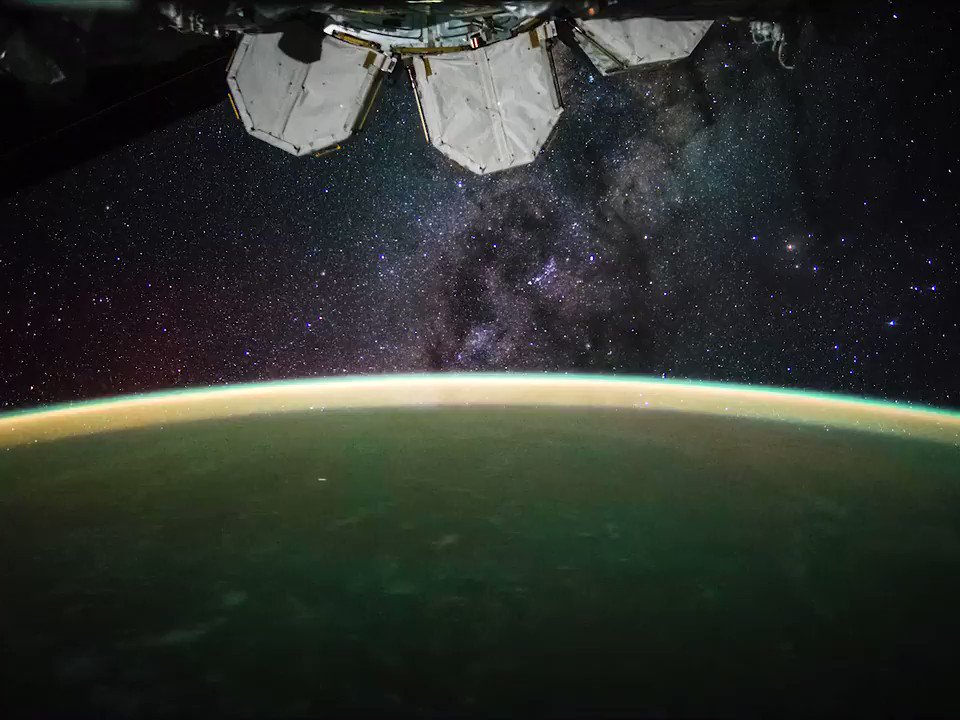 The Milky Way Galaxy and a phenomenon known as airglow seen from the International Space Station.