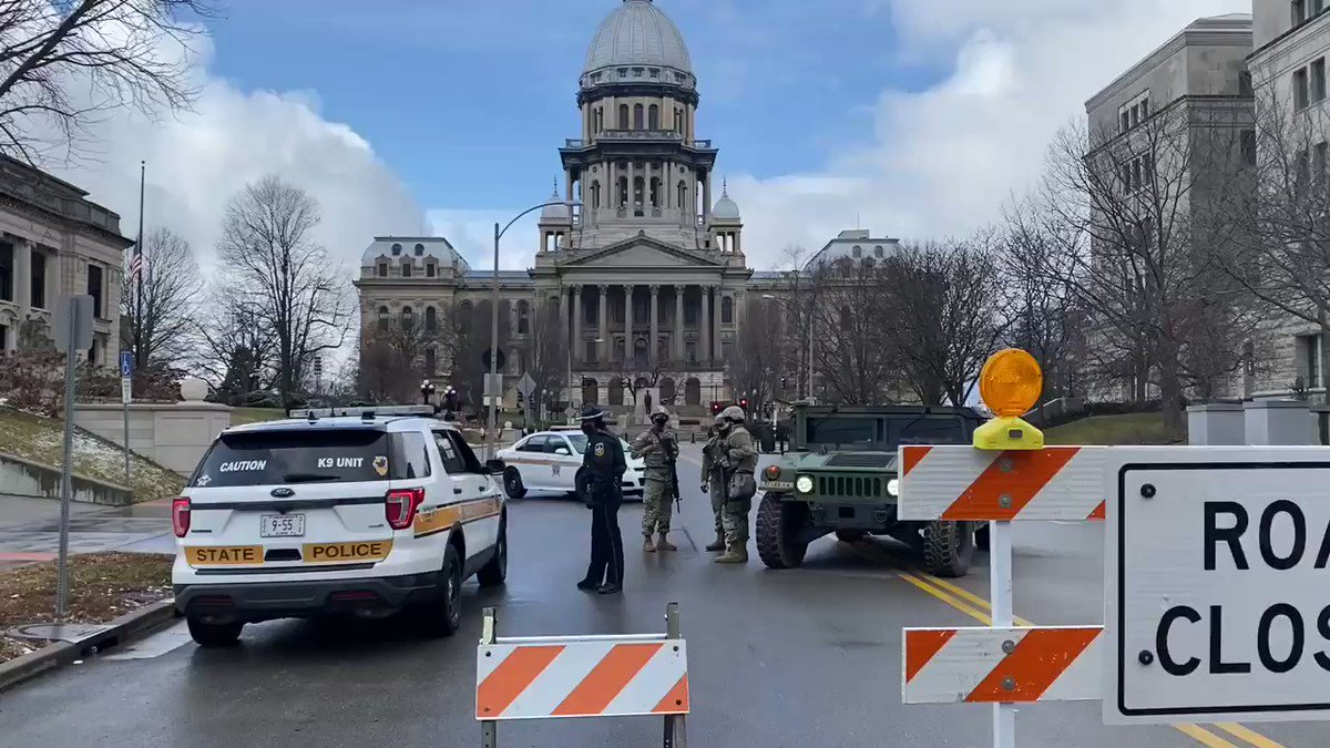A heavily armed platoon of Illinois National Guard formed a perimeter to blockade all access roads leading up to the Illinois State Capitol.