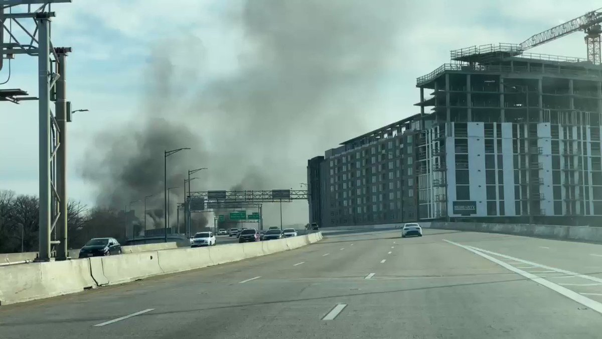 Huge cloud of smoke in Washington DC Freeway at 395- 695 Freeway right. G the Capitol.