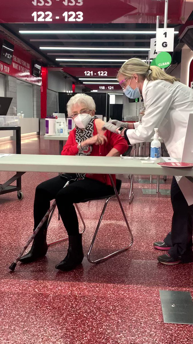 Decked out in scarlet and gray, 100-year-old Helen Formet was the first person to get the #COVID19 vaccine this morning at the official launch of our mass vaccination site at @TheSchott. 💉👏  #TogetherAsBuckeyes #InThisTogetherOhio