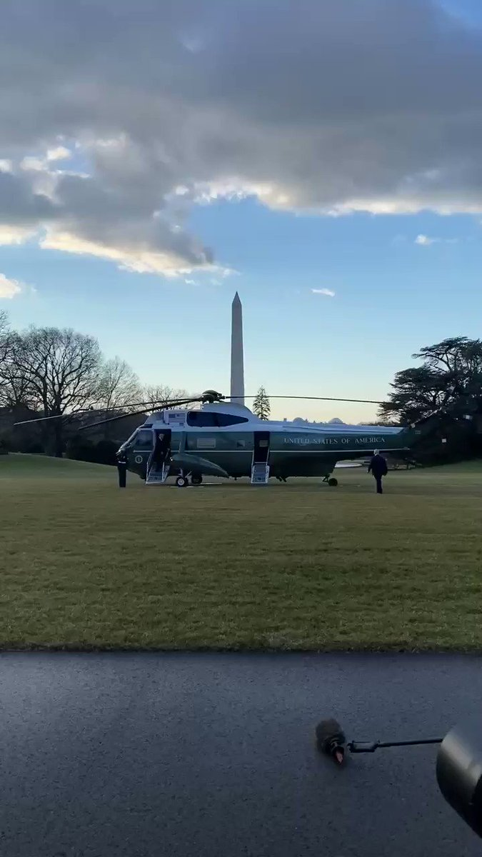 President Trump waves from Marine One as he leaves the White House for the final time.