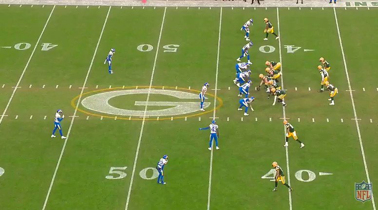 12:38 1Q:  Rams with two-high and 5 DL, only 1 LB in the middle of the field. Packers just play the numbers game and motion 33 out to the flat and 51 follows. Becomes 5v5 and an easy hole to find. Safety has to come down to make a play after 28 gets 9 yards. Nice start. #LARvsGB