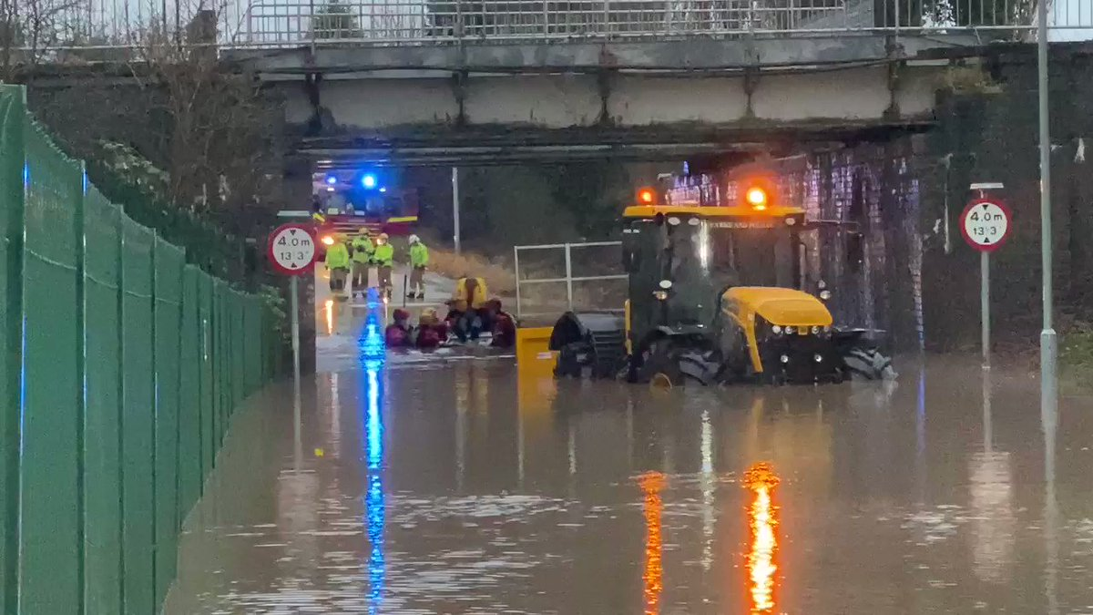 Helping @MerseyFire rescue a guy caught in the flood on lower Rd halewood #jcb #fastrac @LivEchonews