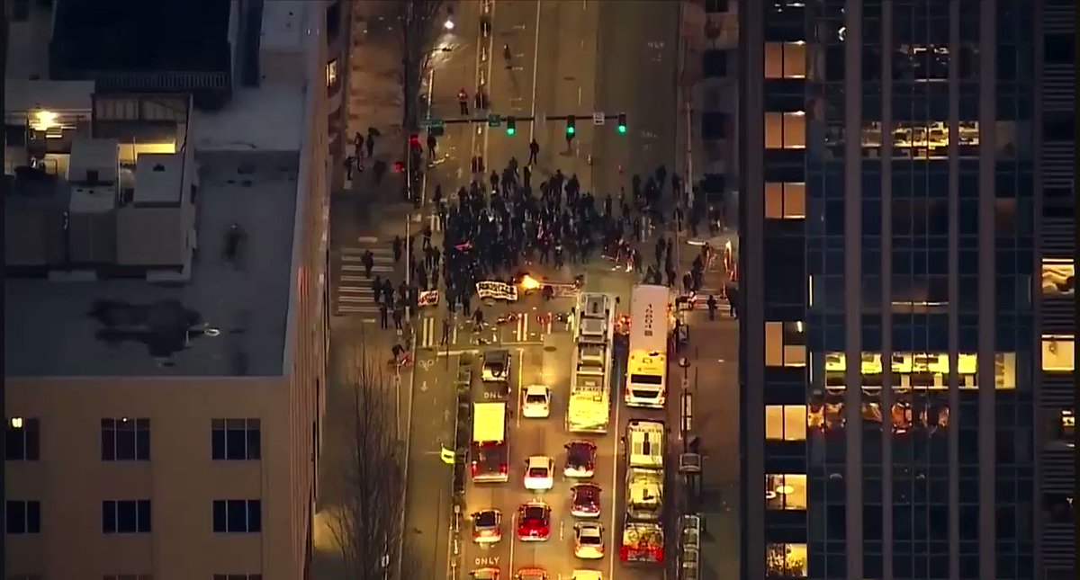 VIDEO: AIR4 was LIVE over Downtown Seattle as anarchists blocked traffic and a lit a large American Flag on fire in the middle of this intersection. #KOMONews