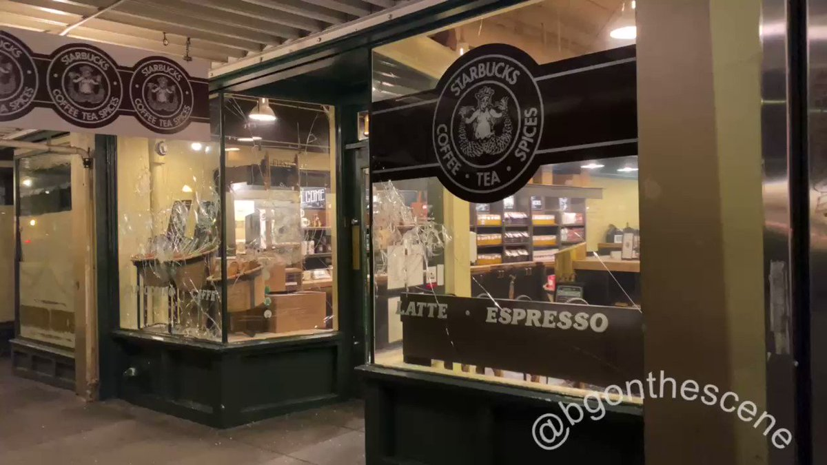 A Starbucks is broken into across from Pike Place Market in Seattle #SeattleProtests #J20 #Seattle #Antifa