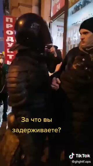 "An incredible scene today in Russia. A riot cop tries to arrest a woman from the sidewalk, drawing a large crowd of outraged people. Then a man steps up and volunteers to take her place, saying ""If you're just meeting your quota, take me instead."" So he does."