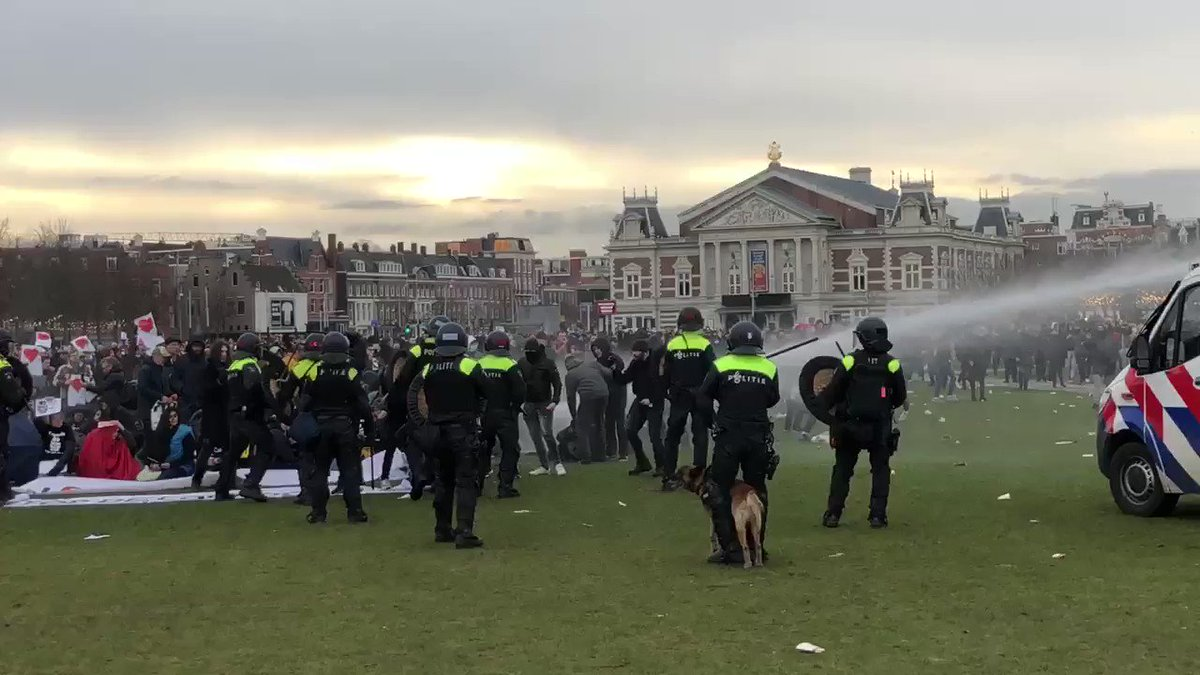 #BREAKING: Dutch police are clashing with anti-#lockdown protestors in #Amsterdam and #Eindhoven. Police are using water cannons to disperse protestors.