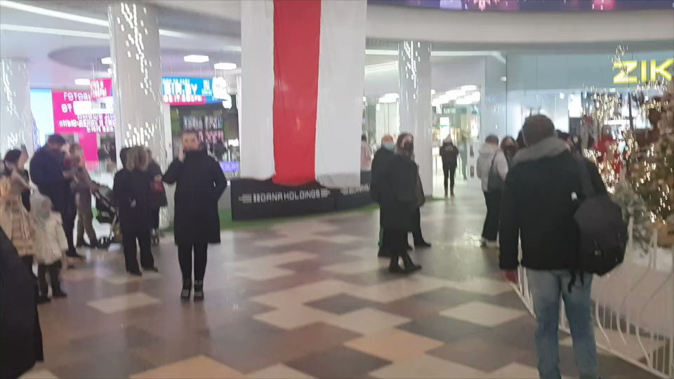 #Belarus Volha Babrova,a mother of five,was accused of hanging this huge white-red-white flag at Dana Mall in #Minsk. She was found by police and held in jail since 22 January. The court decided to fine her $340. Four of her kids are minors. The authorities can take them away
