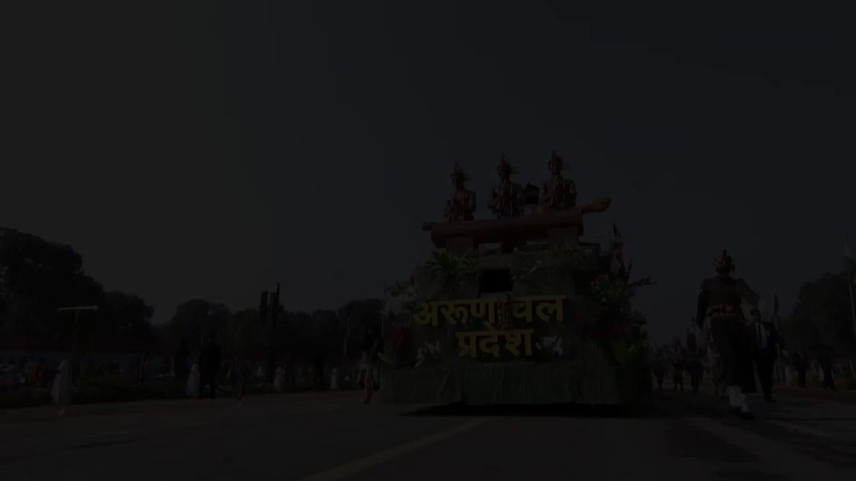 With the theme 'East meets West', #ArunachalPradesh proudly marches in the #RepublicDay  tableau parade 2021 in #NewDelhi.  On display is #Wancho's wooden log drum '#Kham' and the #Chakzam Bridge of #Tawang with cultural display from Wancho and #Monpa tribes.   @MinOfCultureGoI