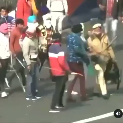 THIS IS HUMANITY!!!!!!!  A Delhi policeman being taken to safety by the farmers !!   #FarmersProtest #TractorRally