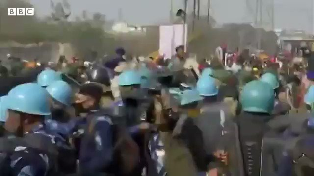 Police barricades being broken by the #Farmers in Delhi. #TractorRally #TractorMarch #FarmersProtest