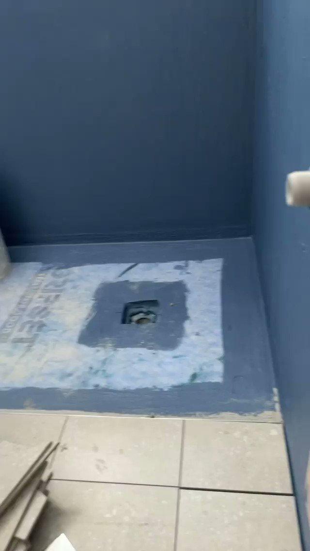 Tiling shower base. 📱