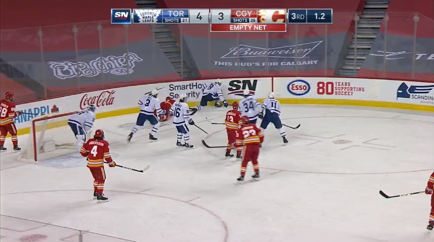 Jake Muzzin flips the puck at Matthew Tkachuk at the end of the game. Full clip. Tkachuk loses it. #NHL #LeafsForever #Flames