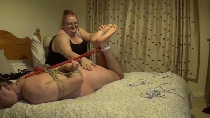 Hogtied man naked and