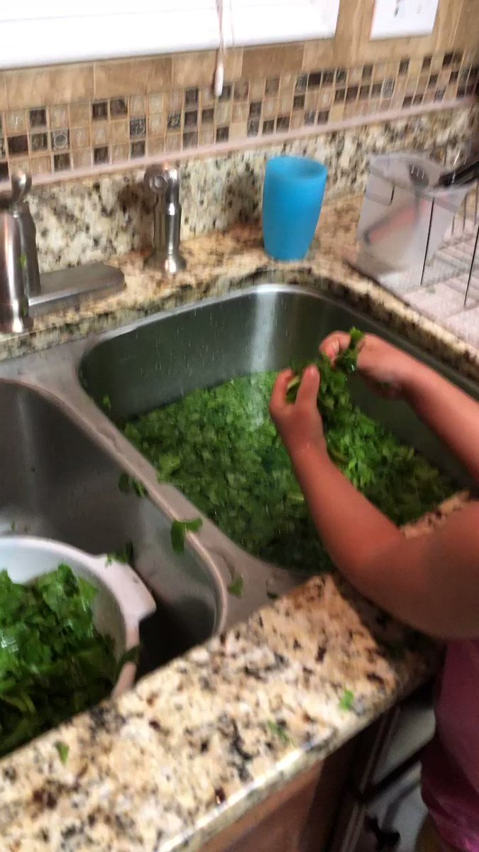 Lawd we went out of town for a few days and my mama had my baby cleaning greens.