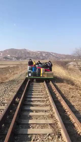 VIDEO: This is how eight Russian diplomats and their family had to get back to Russia from North Korea (on trolleys) because travel links have been cut due to COVID.
