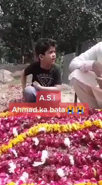 The Innocent Kid of Shaheed ASI trying to Hear from his Shaheed Dad from his Grave.😭😭 #OurForcesOurPride #Pakistan #OurMartyrsOurPride