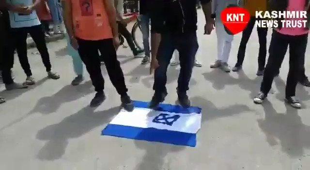 Anti-Israel protests in Srinagar, Israeli flag set on fire. https://t.co/HtvWIC316d