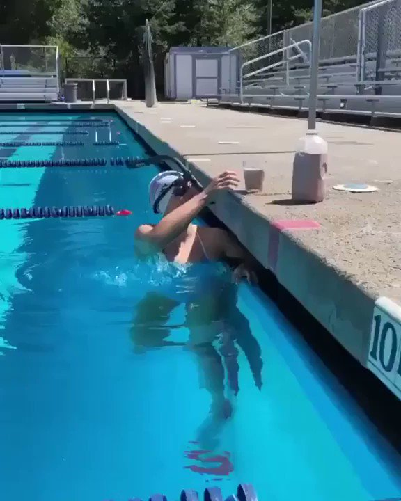 Olympic Gold Medalist Katie Ledecky swimming with a glass of chocolate milk on her head to demonstrate the most efficient swimming technique. No splashing.. https://t.co/kceon3cUHS