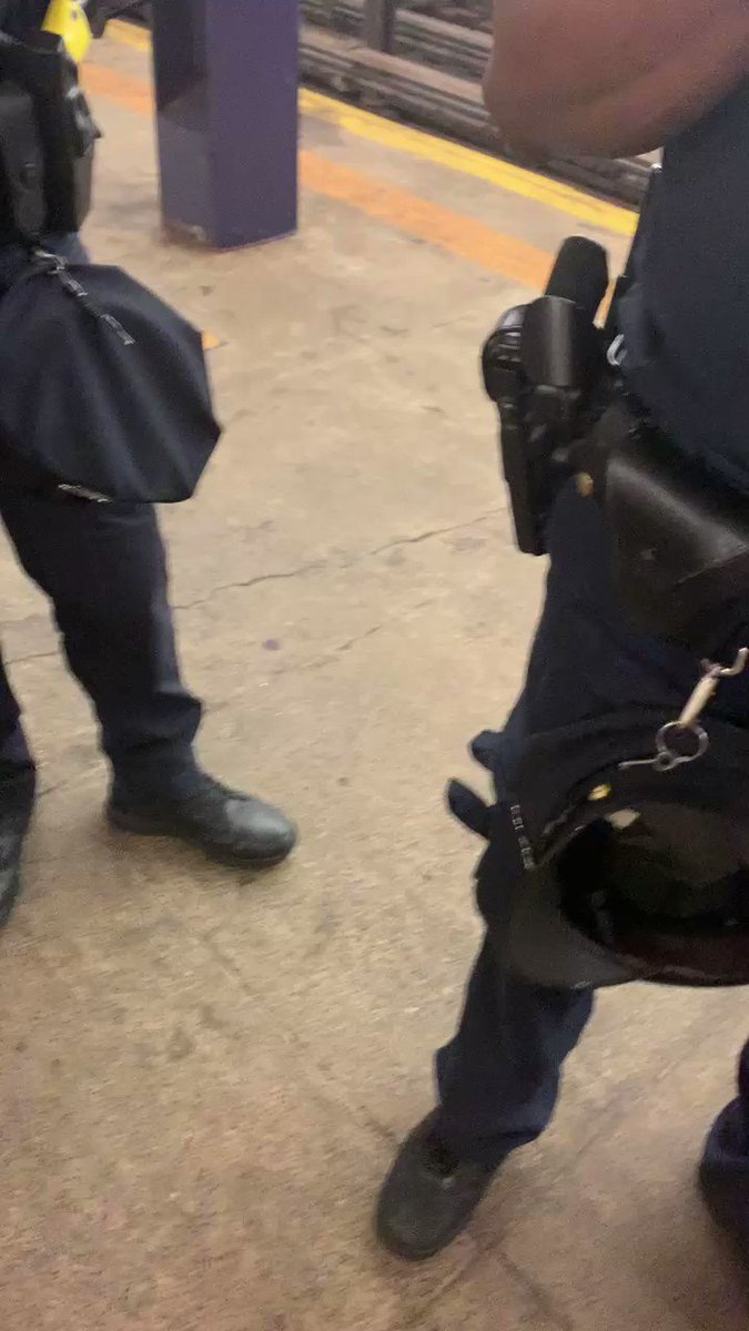 """An NYPD cop in the subway, who openly flouts rules for mask-wearing, tries to intimidate a civilian & brags about how he'll face no consequences.  Then, without any shame, the cop unironically says that he thinks the problem with the USA is that it's too """"free."""" https://t.co/xKDTOaJGxf"""