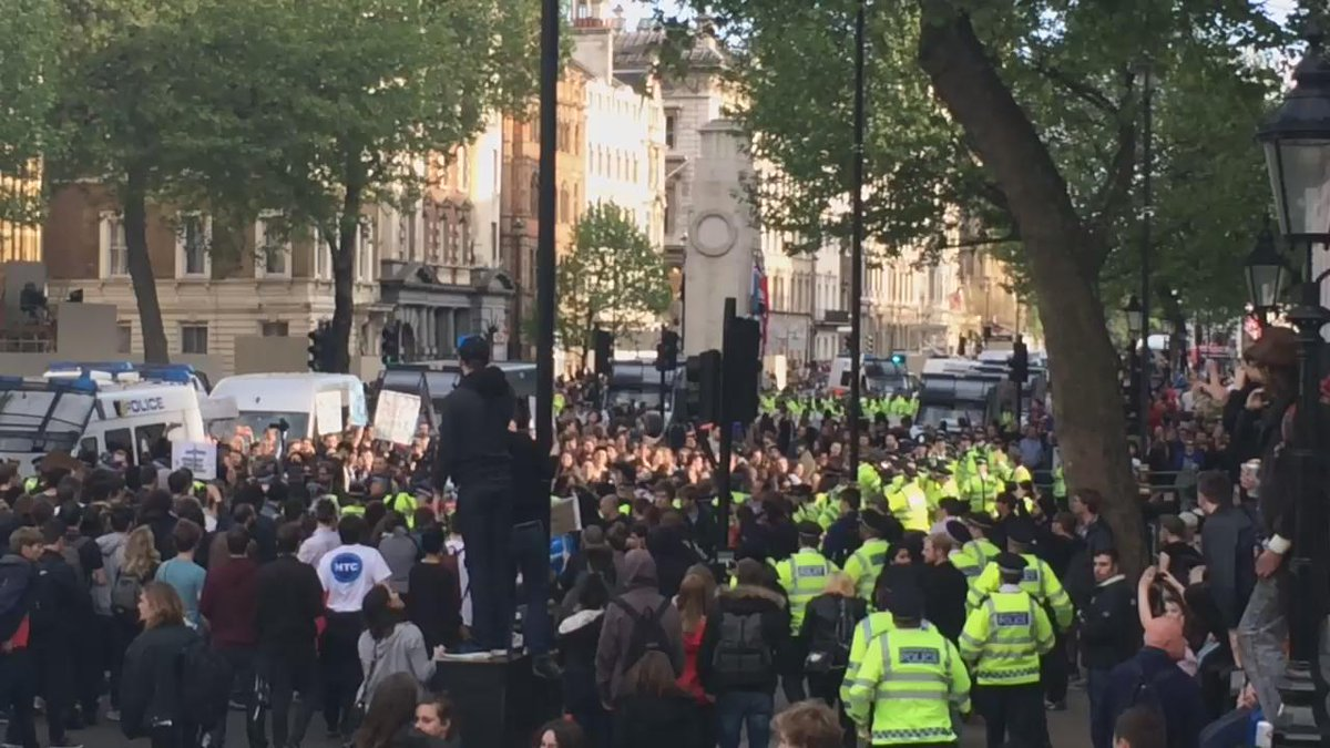 Police are getting violent, starting to kettle protestors outside Downing Street http://t.co/xeV0EuM4lr