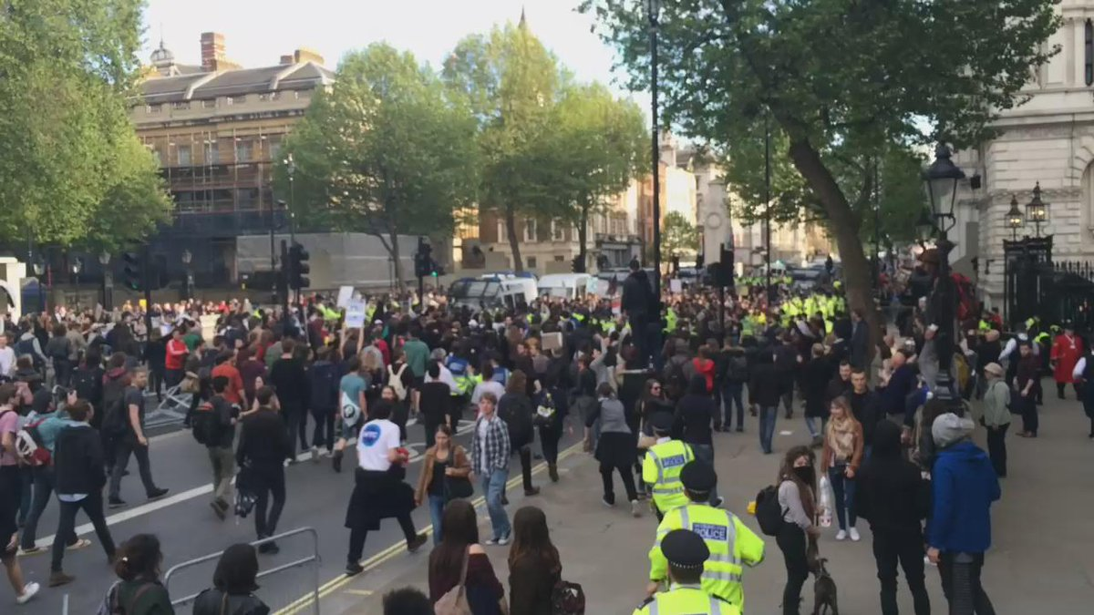 Police getting violent, starting to kettle protestors outside Downing Street http://t.co/TZzcXJRHb6