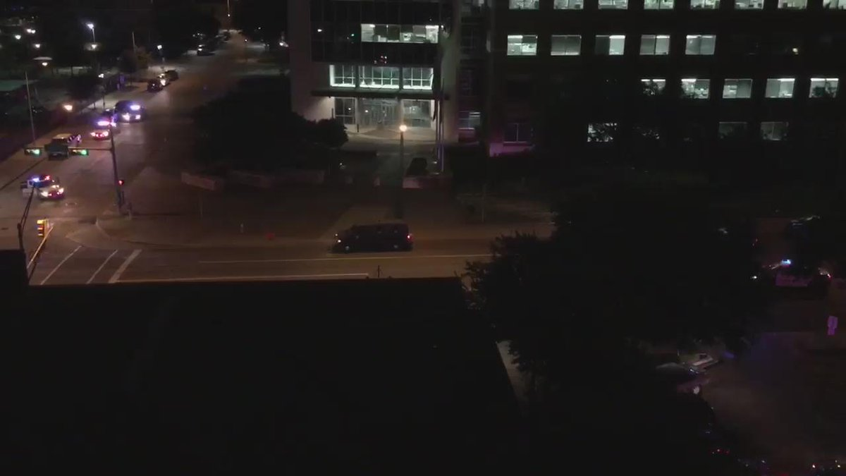 Another video of #Dallas HQ Shooting. RT @madwho12: Armored van lured police, fired upon, and rammed police http://t.co/Au7R5neSoN