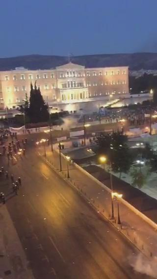 Clashes in #Athens in front of the Parliament. http://t.co/ZRtavSssmZ