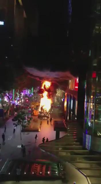 Oh wow. Just received this footage of a Xmas tree on fire at orchard. https://t.co/kCwDM1vZ7C