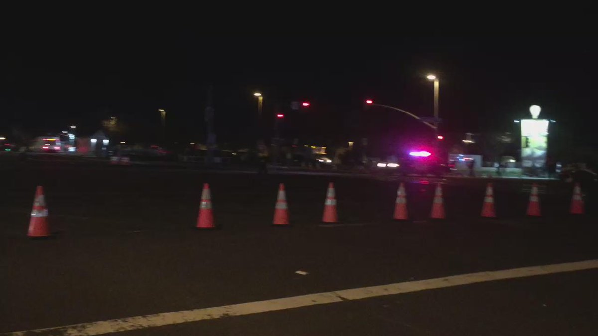Bomb squad & police cars going Code 3 down Great America Parkway. SB50