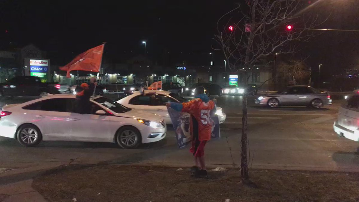 The cars keep coming! Fans lining the street watching the spontaneous parade after the Broncos win. 9News