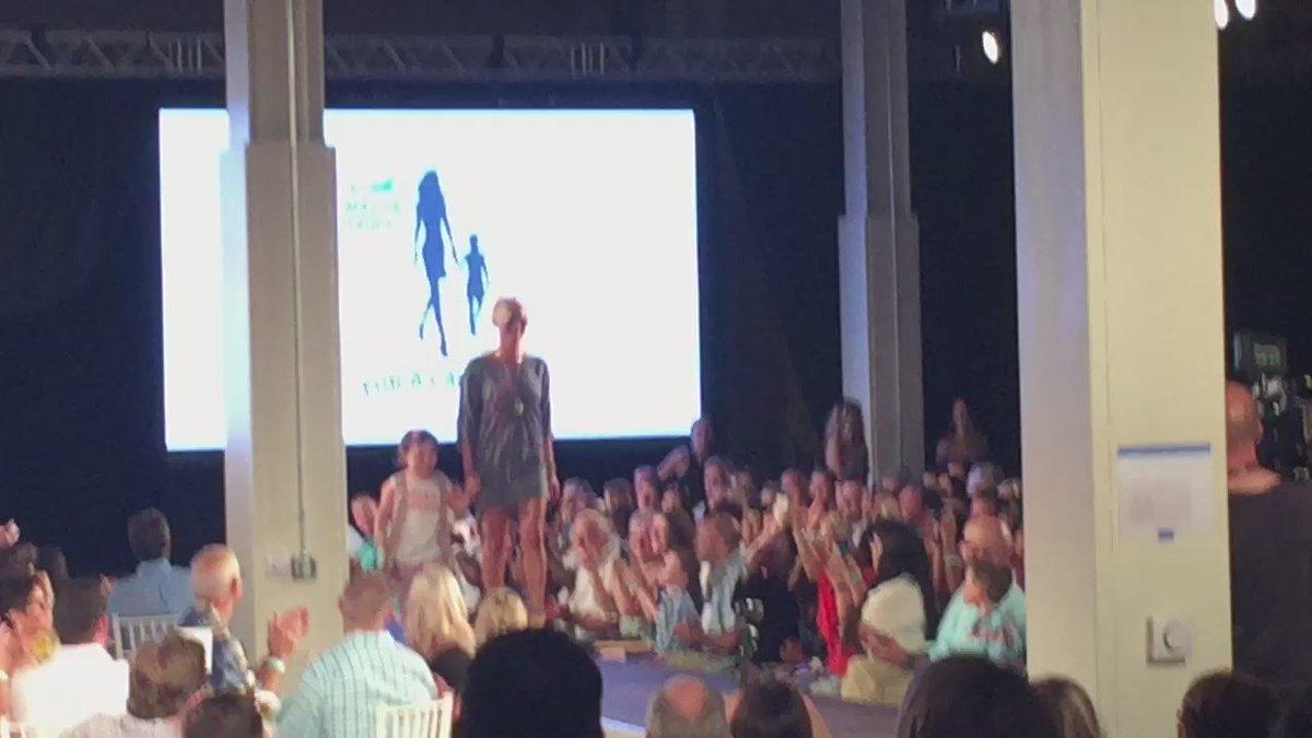 Martin Truex Jr girlfriend Sherry Pollex walks with a child battling cancer during Catwalk For A Cause #MTJFCatwalk https://t.co/xasNLYSmh8