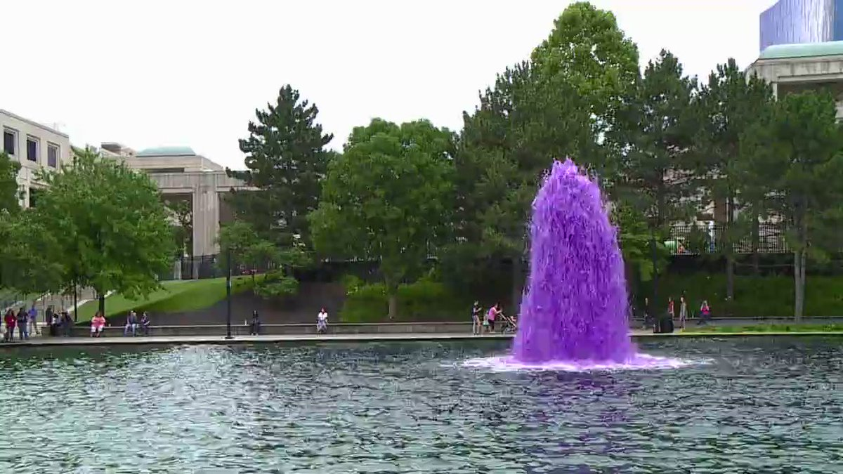 Indy canal dyed purple in honor of retired Navy Seal before Brickyard400