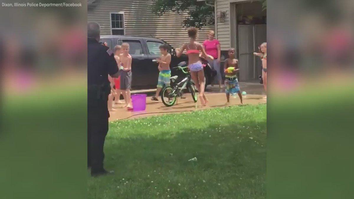 Police in Dixon, Ill. join neighborhood kids in water gun fight