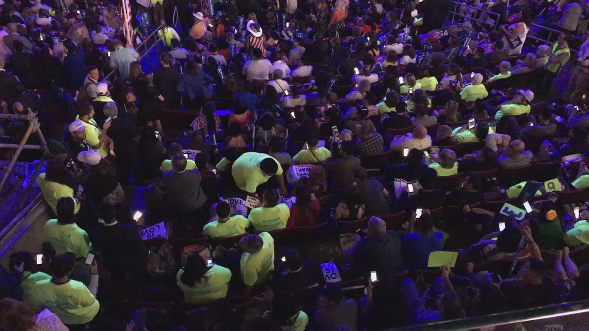 Many Sanders supporters wearing shirts that glow when the lights are down. demsinphilly