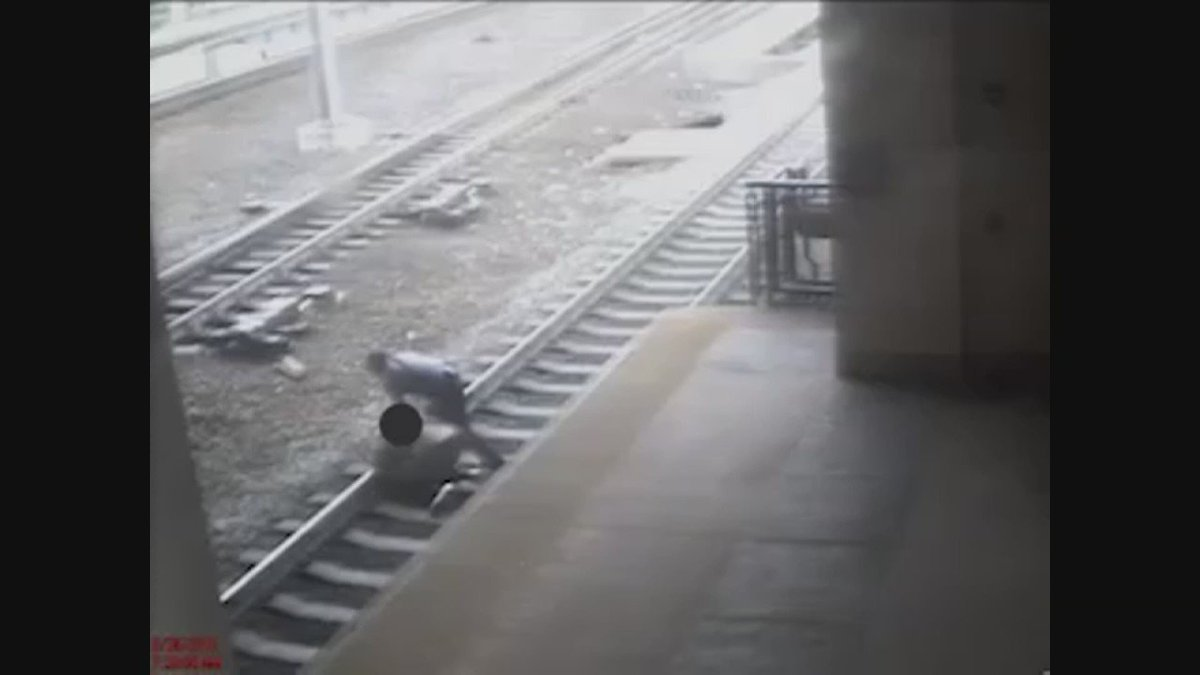 NJ Transit officer hailed as hero for pulling man off tracks (Video courtesy NJ Transit)