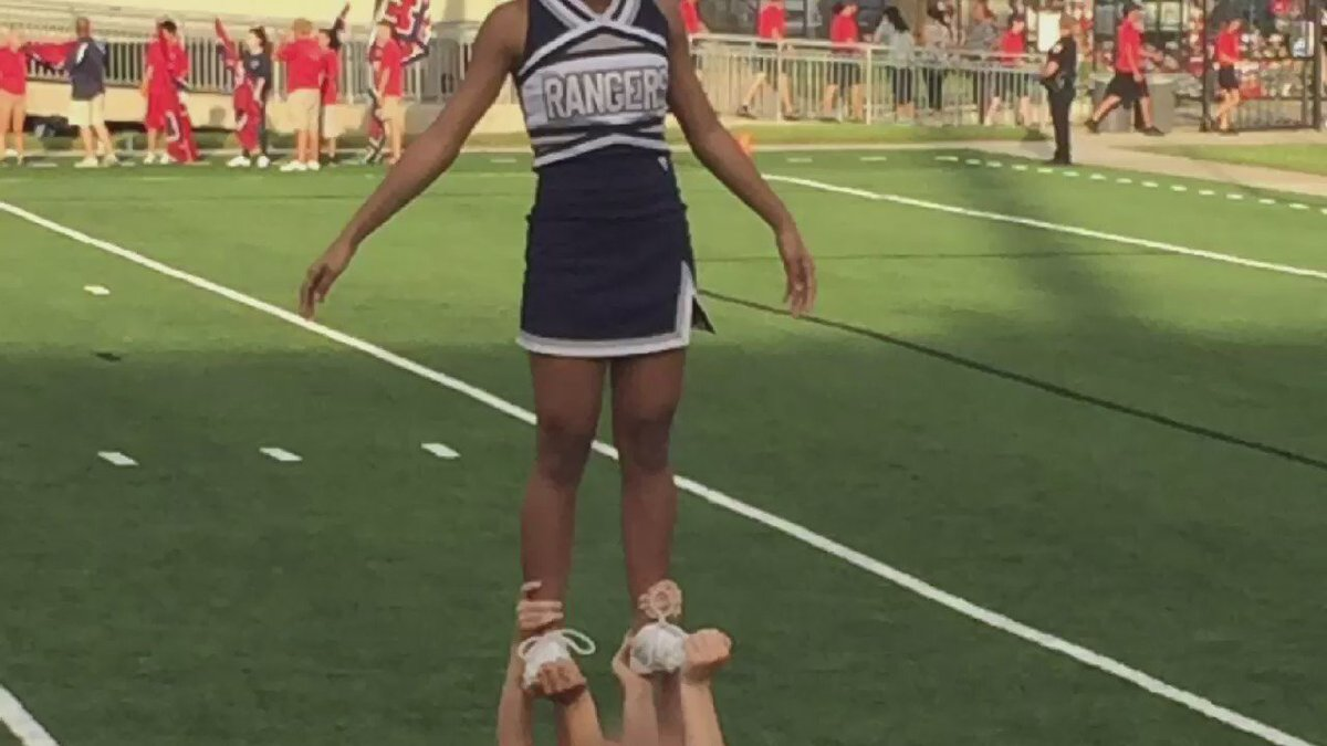 African-American on a Baytown cheer squad says she's discriminated against because of hair.