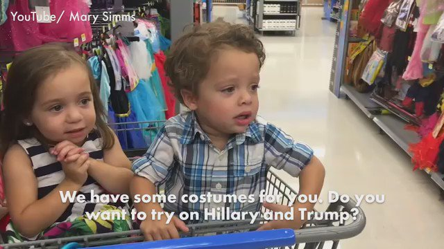 This poor child is terrified by a Donald Trump mask