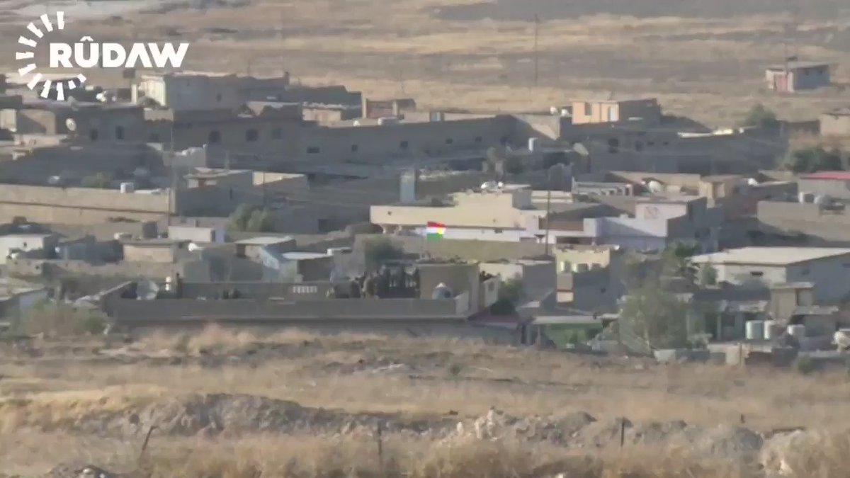 Peshmerga raise the Kurdistan flag over Nawaran village, north of Mosul