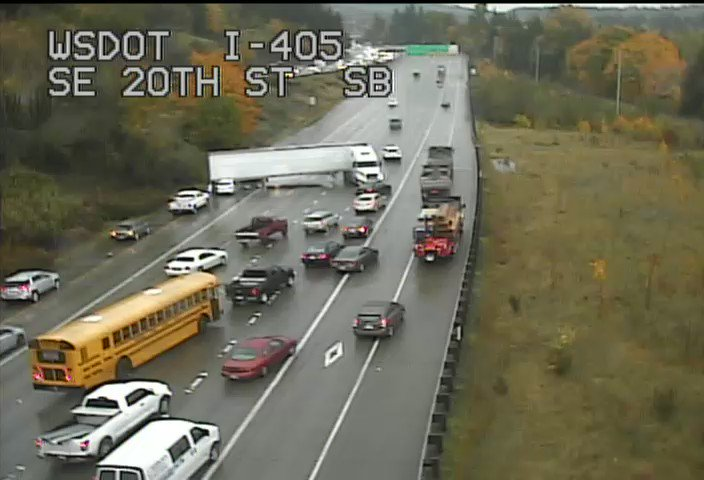 Left five lanes of SB 405 blocked just north of I-90. If you're going Bellevue to Seattle - use 520!!