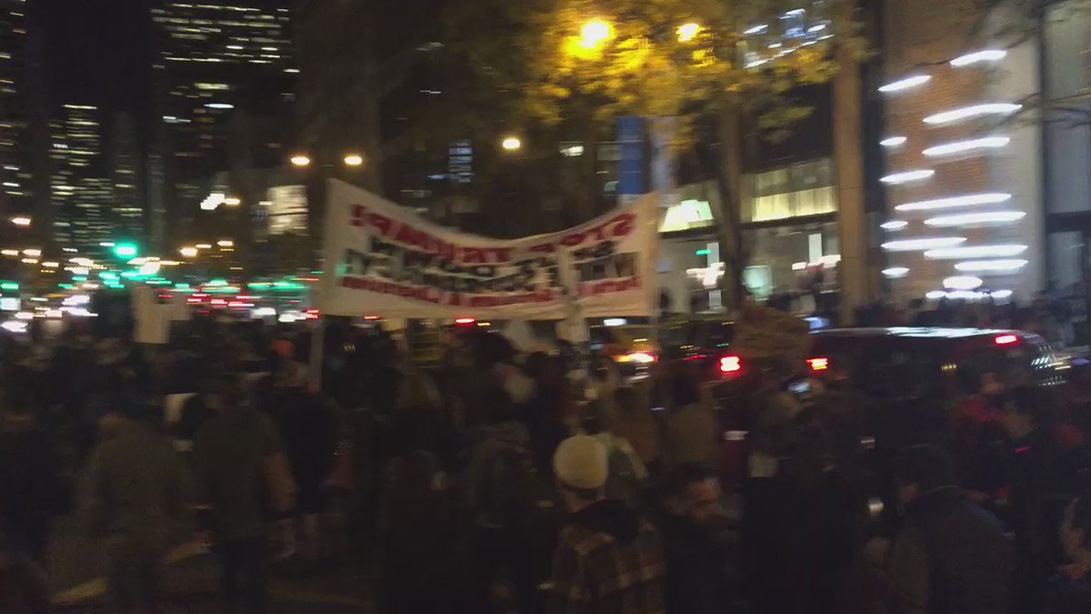 Anti-Trump march heads up the Magnificent Mile. Taking up all six lanes of Michigan Avenue. https://t.co/gKbRDT4OcX