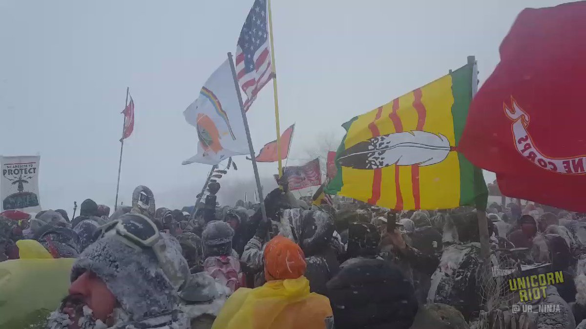 Six flag carriers braved the 50-60 mph winds  and  brought USA flag to Najavo Nation's #OcetiSakowin #NoDAPL camp during ceremonial vets march.