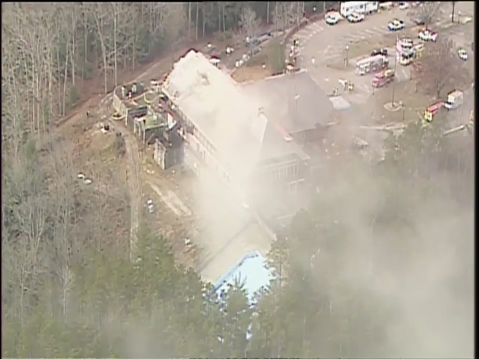 Firefighters continue to battle flames at the Hocking Hills Dining Lodge.